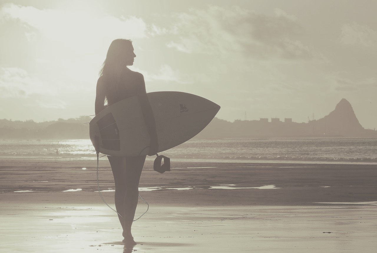 Girl surfing on the beach
